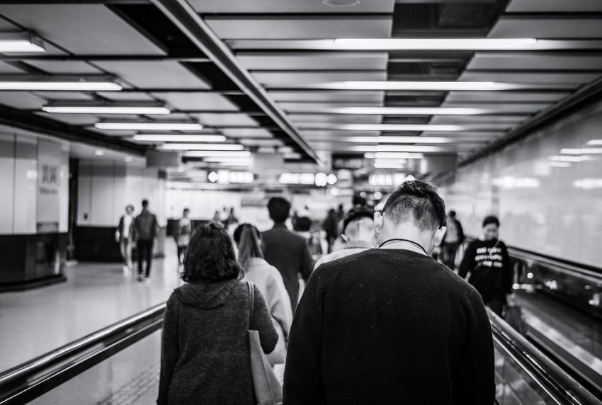 Blackandwhite Hkbw Monochrome Reframinghk Street Photography Discoverhongkong Group Of People Real People Crowd Large Group Of People Transportation Indoors  Men Public Transportation Women Adult Architecture Mode Of Transportation Travel Lifestyles Subway Station Passenger Commuter Illuminated Rear View Ceiling