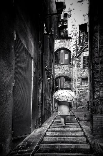 raining Raining Rain Umbrella Umbrella☂☂ Walking Around The City  Urban Lifestyle Blackandwhite Black And White Black & White Blackandwhite Photography Black And White Photography EyeEm Best Shots - Black + White Architecture Building Exterior Built Structure Alley Narrow Walkway Urban Scene Stairs Paved Cobblestone Old Town Building