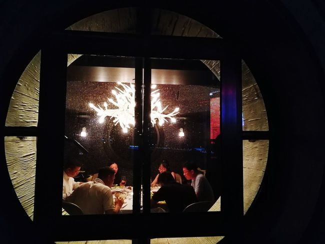 Behind the window Window Indoors  Adult People Illuminated Night Adults Only Peek Inside Peekhole Glass Windows Discussion Dinner Dinner With Friends Dinner Time China Style China In My Eyes EyeEm Traveling Travel Photography EyeEm Travel Photography Shanghai