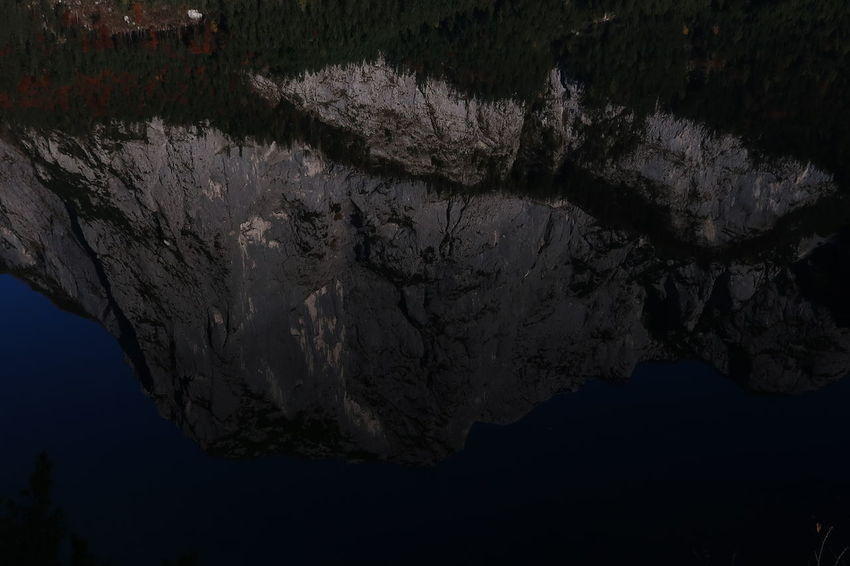 The dark side 007 Altaussee Austria Lost In The Landscape Mirror Reflection Rock Beauty In Nature Day Lake Mountain Nature No People Outdoors Scenics Spectre Tranquility Water EyeEmNewHere Perspectives On Nature
