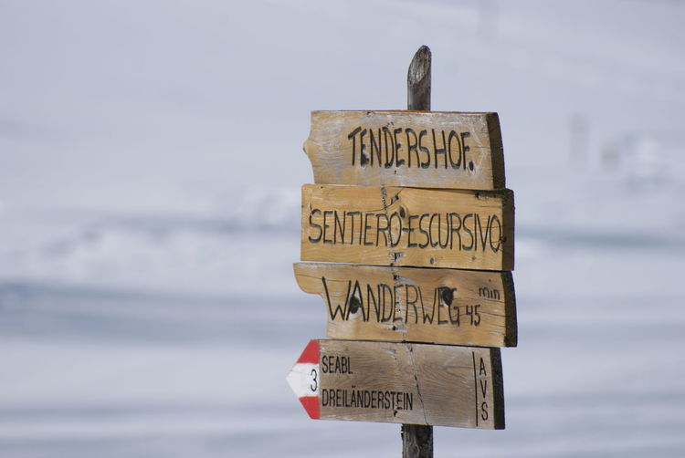 Vinschgau-Ski_14 Vinschgau Italy Schöneben Reschen Reschensee Skiing Ski Snow Powder Text Communication Western Script Sign Water Sea Sky No People Nature Day Wood - Material Guidance Information Sign Cloud - Sky Information Arrow Symbol Outdoors Directional Sign Close-up