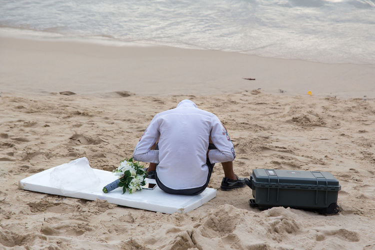 Surin Beach, Phuket, Thailand BangTao Beach Beach Life Bouquet Day Decapitated Headless Humor Loneliness Ocean One Person Outdoors Phuket Rear View Robinson Crusoe Sand Sea Sommergefühle Street Photography Streetphoto Streetphotography Summer Surin Tourist Travelling