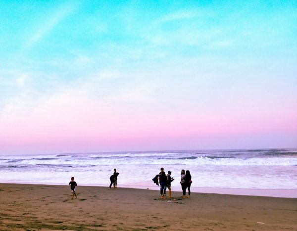 Purple. Beach Sea Sand Water Sunset Sky Vacations People Outdoors Nature EYECAMAWARDS EyeEm Best Shots Wave Sport Day First Eyeem Photo Breathing Space EyeEmNewHere Investing In Quality Of Life
