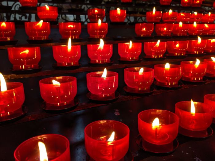 Lit tea light candles in temple