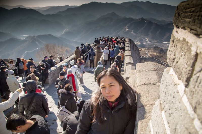 Woman standing on great wall of china
