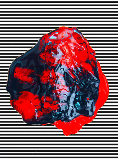 Close-up of red paint over colored background
