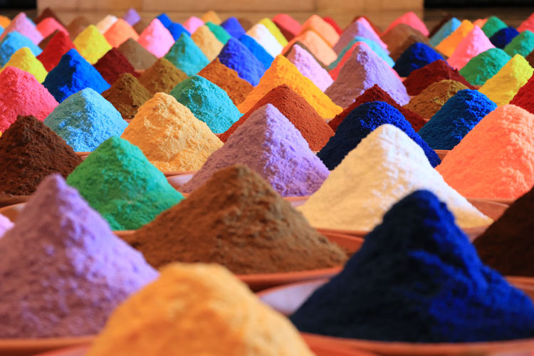 Colorful powder paints for sale at market stall