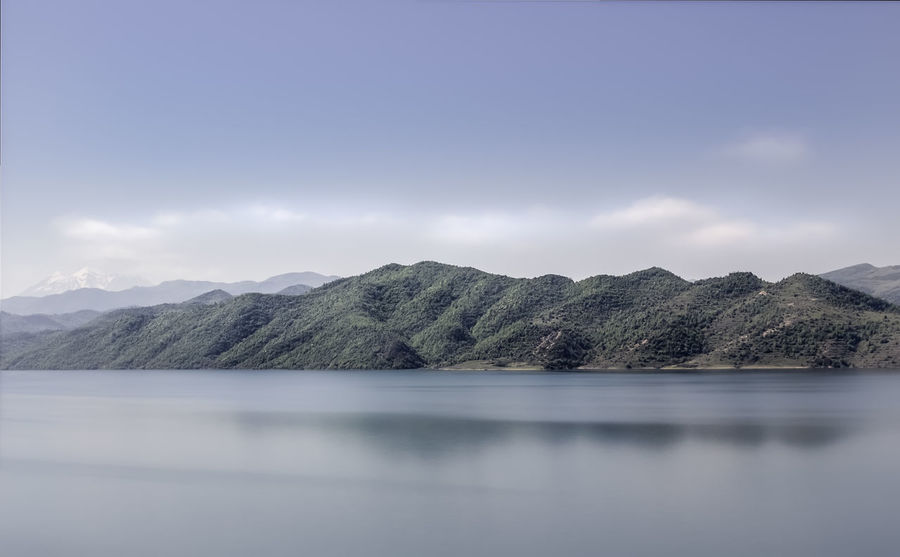 Albania Beauty In Nature Cloud - Sky Day Idyllic Lake Long Exposure Mountain Mountain Range Nature No People Non-urban Scene Outdoors Remote Scenics - Nature Sky Tranquil Scene Tranquility Water Waterfront