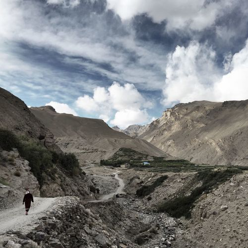 Rear view of woman on walkway against pamir mountains