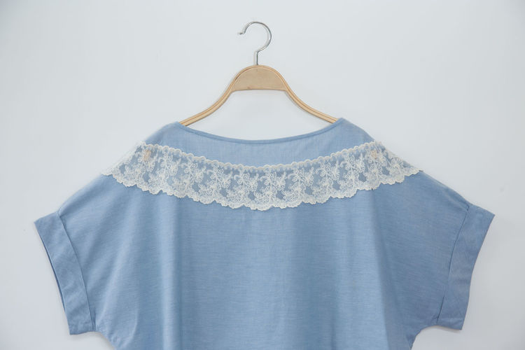 Natural colour blue clothes is clothes hanger on white background.close up Beautiful Beige Casual Dress Elegant Fashion Knitting Lady Beauty Blank Blouse Casual Clothing Cloth Clothes Clothes Hanger Clothing Clothing Store Color Cotton Design Fabric Female Girl Lace Lace - Textile