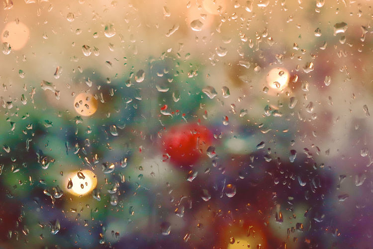 🎼der Sommer ist vorbei.....lalala🎼 Colorful Vivid Bokeh Through The Window Drop Wet Glass - Material Water Window Transparent Rain Backgrounds No People Full Frame Rainy Season Indoors  Close-up RainDrop Nature Glass Sky