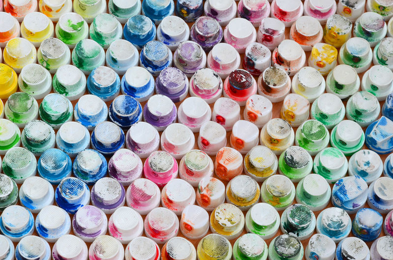 Full frame shot of abandoned spray bottle caps