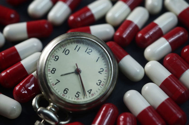 Close-up of stopwatch with capsules