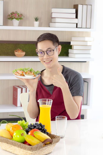 Portrait of smiling young man having food