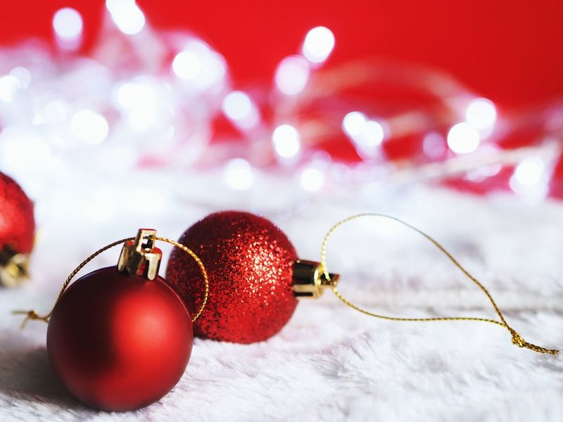 Christmas ball decoration On red background ,happy Christmas concept. Bauble Celebration Event Christmas Christmas Ball Christmas Decoration Christmas Ornament Close-up Day Focus On Foreground Food Food And Drink Freshness Fruit Hanging Indoors  No People Red Snow