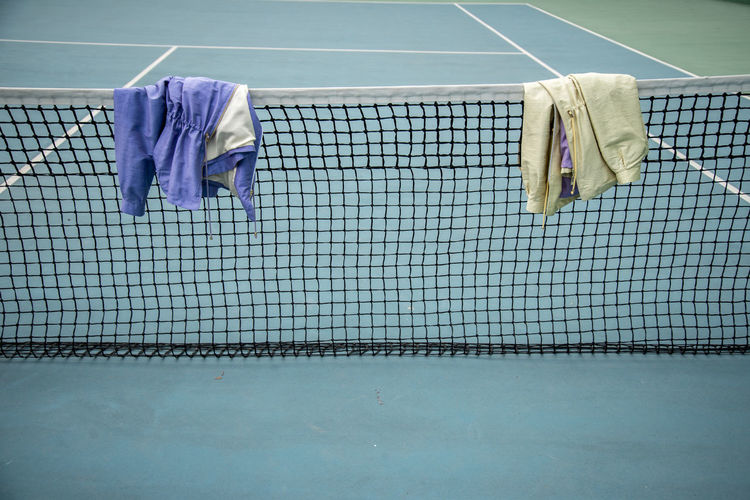 Jackets on net at sports field