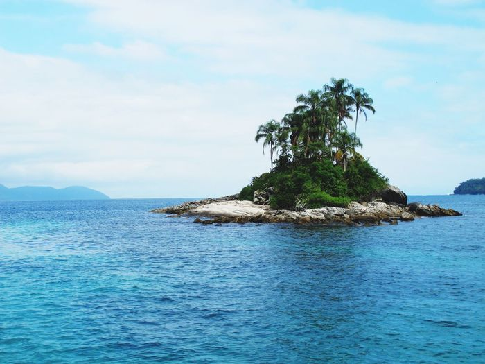 Paradise Island Water Sky Beauty In Nature Sea Waterfront Cloud - Sky Tranquility Tranquil Scene Scenics - Nature Tree Plant Nature No People Day Idyllic Rippled Blue Outdoors Non-urban Scene