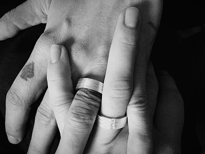 Close-up of couples hands clasped