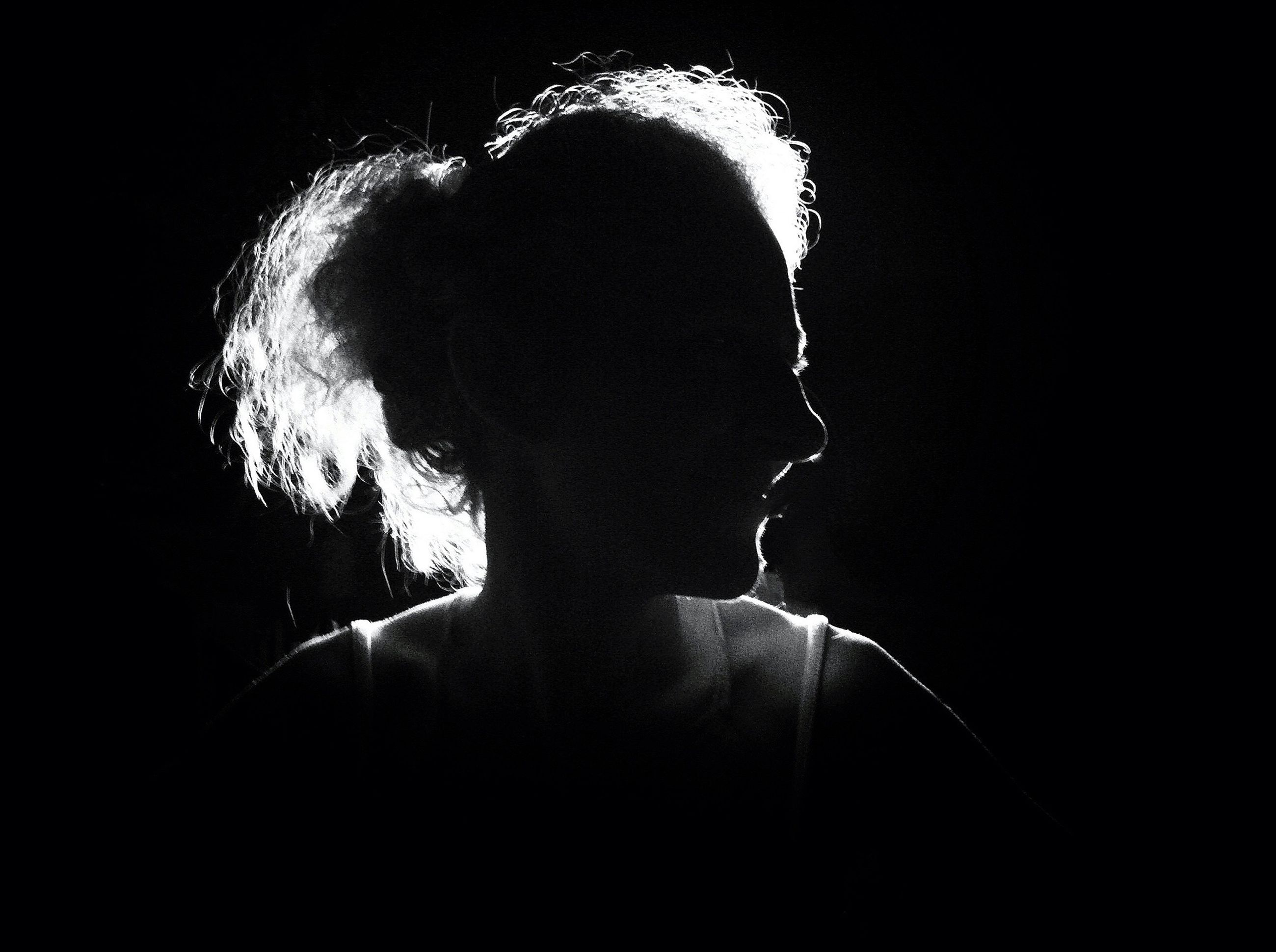 lifestyles, leisure activity, men, night, silhouette, indoors, dark, person, togetherness, love, illuminated, headshot, standing, rear view, holding, three quarter length, light - natural phenomenon