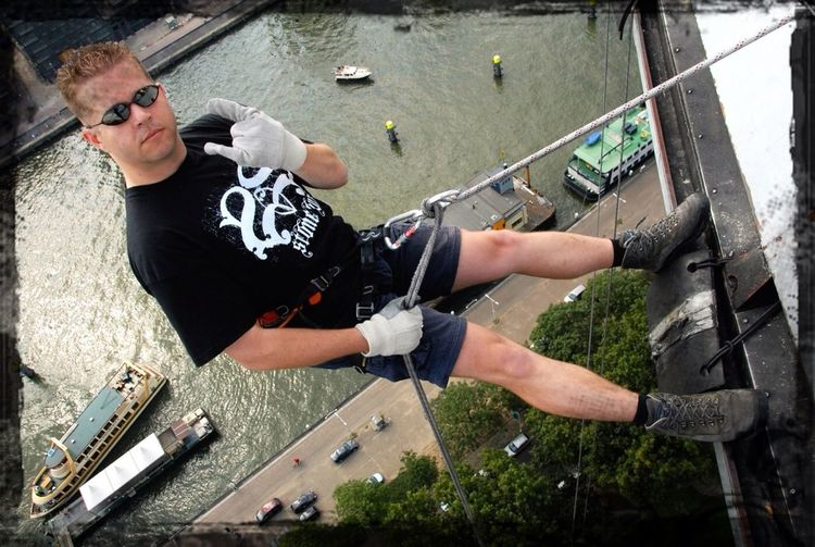High Angle View Of Man With Ropes In Carabiner Attached To Waist