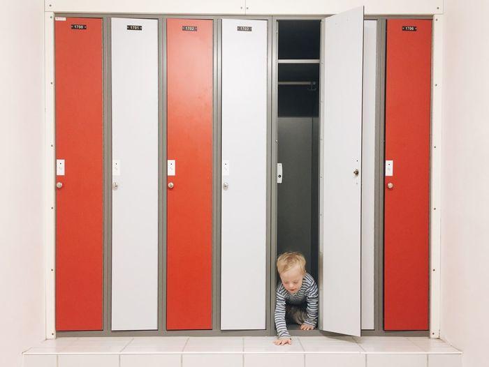 Playful Boy Hiding In Locker