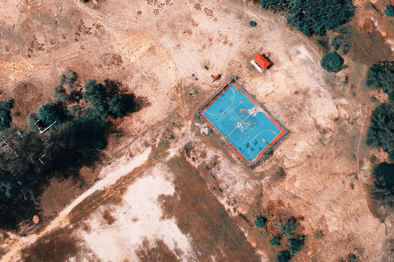 Aerial view of soccer field amidst landscape