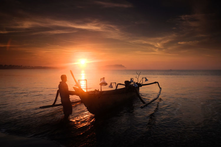 fisherman Water Nautical Vessel Sea Sunset Fisherman Beach Occupation Rowing Silhouette Standing Fishing Net Fishing Boat Fishing Tackle Longtail Boat Commercial Fishing Net Fishing Rod Fishing Catch Of Fish Trawler Fishing Equipment Buoy Outrigger Wake Fishing Hook Fishing Industry Krabi