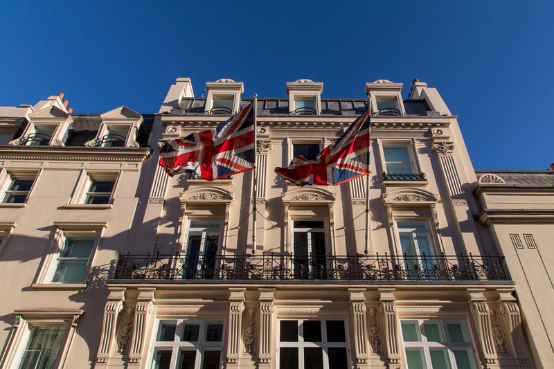 Union Jack at the building Architecture Balcony Blu Sky Building Exterior City Clear Sky Day Flag Low Angle View No People Outdoors Sky Townhouse Travel Destinations Union Jack Windows