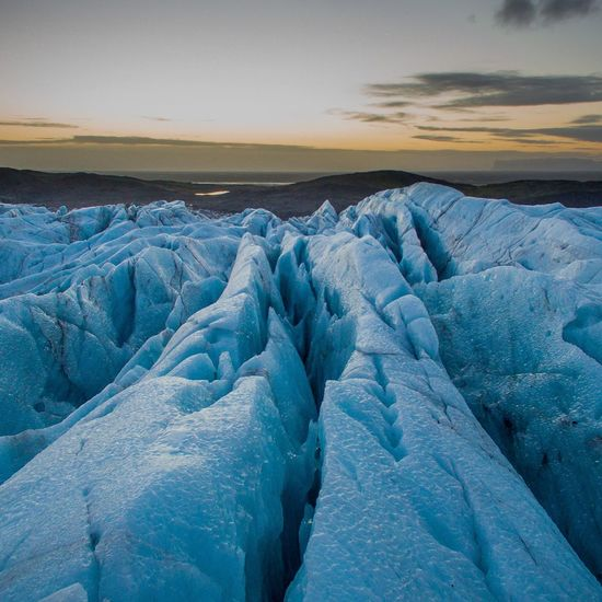 EyeEm Selects Scenics Landscape Blue Travel Destinations Beauty In Nature Sea Polar Climate Awe Dramatic Sky Sunset Travel Nature Tourism Cloud - Sky Ice Cold Temperature Environment Idyllic Water Sky