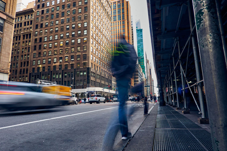 Blurred motion of man on city street in manhattan new york