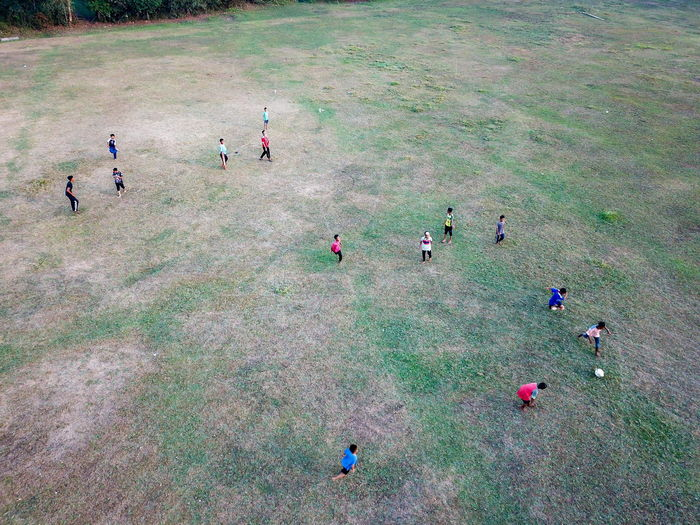 High angle view of people on field