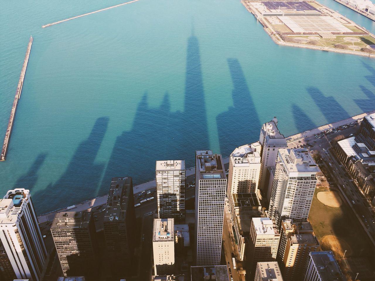 Shadow of city skyline on sea