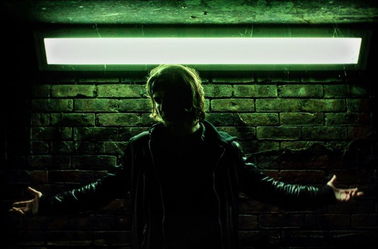EyeEmNewHere Brick Wall One Person Real People Rear View Lifestyles Green Color Underground Standing Day Indoors  Blond Hair Architecture Young Adult Adult People