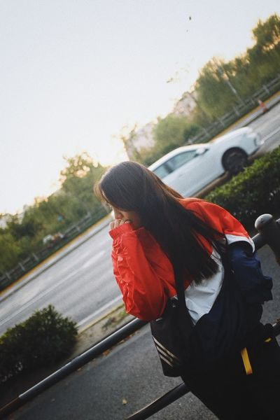 People Watching Car Casual Clothing Clear Sky Day Focus On Foreground Hairstyle Land Vehicle Leisure Activity Lifestyles Mode Of Transportation Motor Vehicle Nature One Person Outdoors Real People Road Sky Standing Three Quarter Length Transportation Women