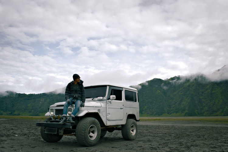 My brother in Bromo Mountain crater. 4x4 Adult Adults Only Adventure Adventure Club Betterlandscapes Cloud - Sky Day Driving Expedition Explore ExploreEverything Exploring New Ground EyeEm Nature Lover Land Vehicle Mode Of Transport Mountain Mountain Range Nature Photographer One Person Outdoor Outdoors Sky Transportation Young Adult Breathing Space
