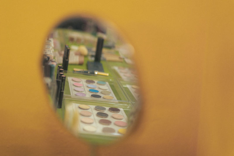 Selective Focus Indoors  Close-up No People Technology Toy Yellow Focus On Background Still Life Wall - Building Feature Machinery Finance Retro Styled High Angle View Leisure Games Connection Equipment Green Color Make-up Palette