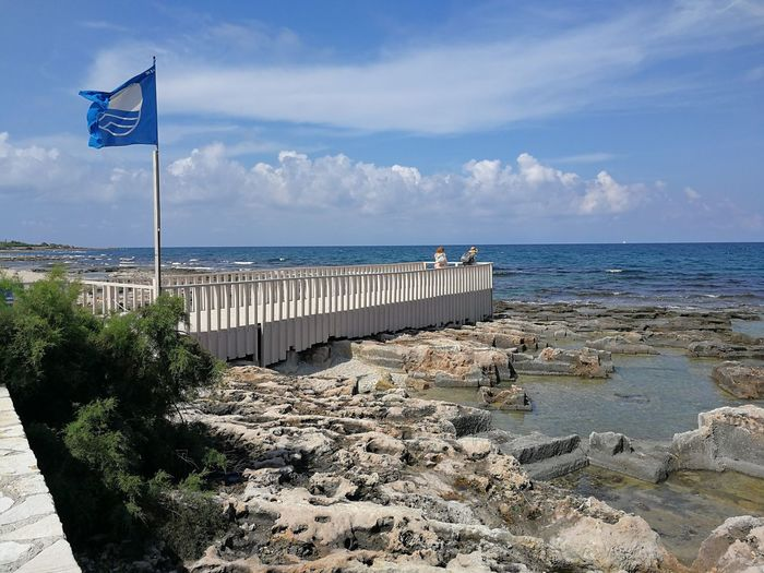 Water Sea Sky Scenics - Nature Flag Horizon Over Water Beauty In Nature Beach Nature Horizon Land Cloud - Sky Day Rock Patriotism Tranquil Scene No People Solid Rock - Object Polignano A Mare Bandiera Blu Scogliera Adriatic Sea Pontile Turistic