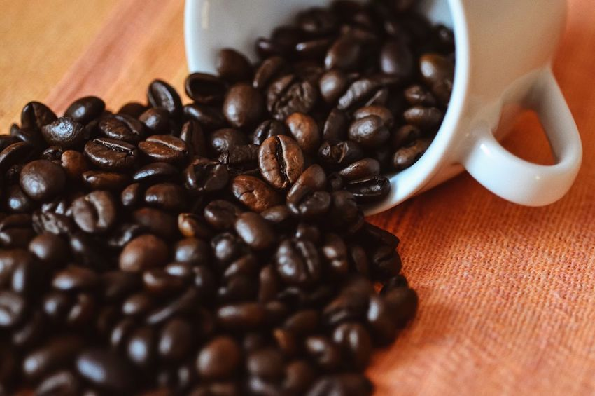 Caffeine... Food And Drink Roasted Coffee Bean Coffee Bean Coffee - Drink Coffee Cup Table Freshness Food Refreshment Brown Raw Coffee Bean Drink Group Of Objects Still Life Selective Focus Macro Caffeine Coffee Perfume Aroma Cappuccino Espresso Flavor Scent Coffee Beans