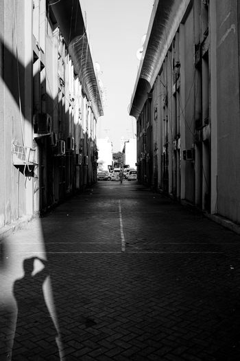 Shades Of Grey Shadows & Lights Alley Architecture Black And White Photography Blackandwhite Building Exterior City Dubai, Mirror Reflection Mirrorless Outdoor Photography Shadow Street Street Life, Street Photography Streetphoto_bw Streetphotography Uae,abudhabi Visual Creativity