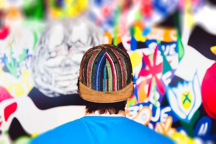 Rear view of man wearing cap
