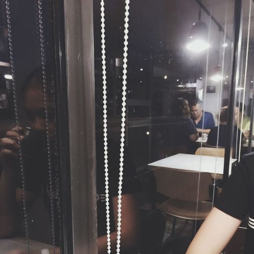 Restaurant Window Night Indoors  One Person Real People Young Adult People
