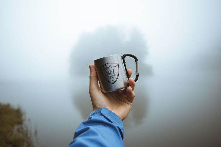 Man holding coffee cup of water