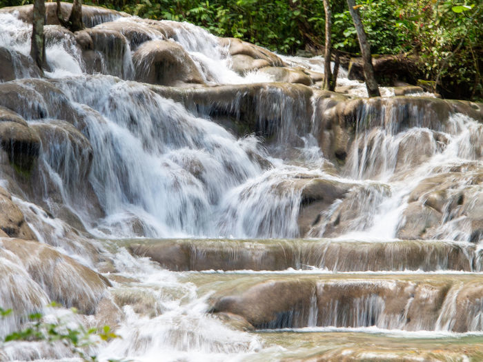 Dunns River Falls in rainforest Jamaica Beauty In Nature Nature Outdoors Waterfall Falls Dunns River Falls Dunns Falls Stone Water Falling Water Rocks Tropical Tropical Forest
