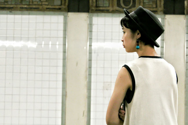 it is midnight in New York City - A girl with a blue pearl earring midnight casual clothing Midnight Subway Station Young Adult Standing Portrait Blue Pearl Girl Streetphotography Hat Asian Girl Gistilish Glamour Casual Clothing Glam Glamour Girl Glamour Glamourous Glamour Fashion Beauty Photographer Subway Portraits New York New York City Newyork Subway Subwayphotography