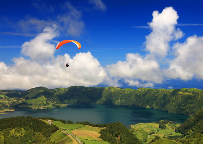 Canon Adrenaline Adrenaline Junkie Extreme Paragliding Sete Cidades Adrenaline Rush Adventure Beauty In Nature Cloud - Sky Day Extreme Sport Extreme Sports Flying Leisure Activity Mid-air Nature One Person Outdoors Parachute Paragliding Paragliding Over Water Real People Sete Cidades Azores Sky Sport