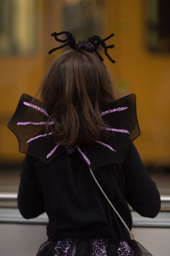 Rear view of woman with umbrella
