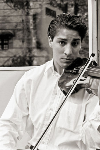 Portrait of young man playing violin