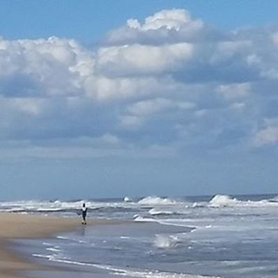 Surfers heading out to catch some Waves Oceancitycool OceanCity Maryland Ocmd Surfing