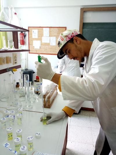 Side View Of Man Working In Laboratory