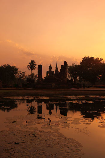 Silhouette Buddha Statue At Wat Sa Si During Sunset